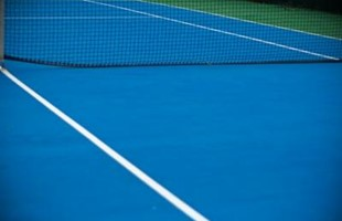 Image of ground of empty tennis court.