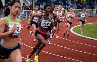 Female athletes competing on running track